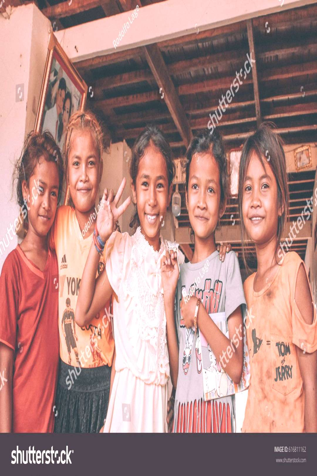 KRATIE, CAMBODIA ¨C APRIL 20 2016 Unidentified girls posing for a picture in a poor village aroun